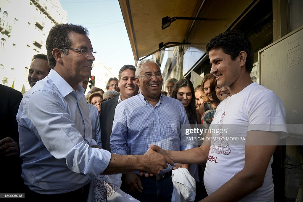 Lisbon's Mayor and local election candidate Antonio Costa and secretary general of the Socialist Party Antonio Jose Seguro greet supporters on...