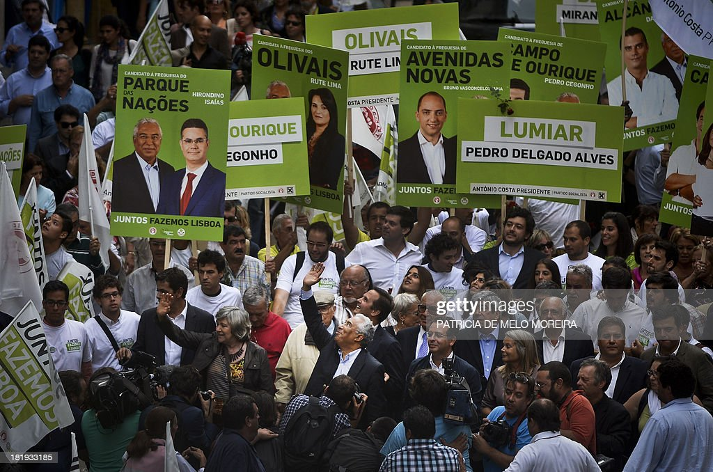 Lisbon's mayoral candidate Antonio Costa waves to supporters next to Portuguese Socialist Party general secretary Antonio Jose Seguro during a...