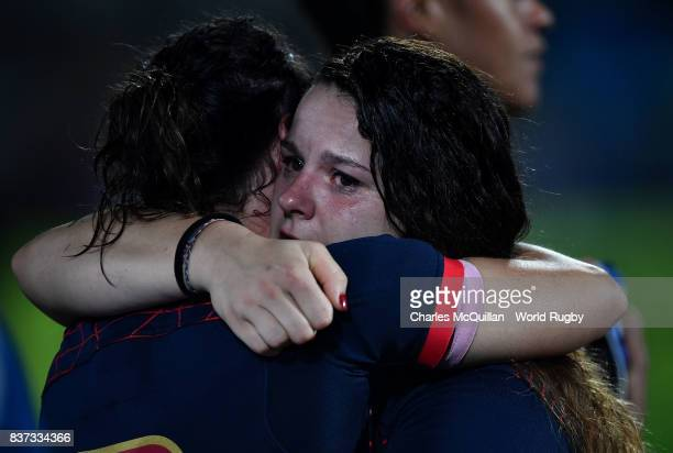 Lise Arricastre of France is comforted after the Womens Rugby World Cup semifinal between England and France at the Kingspan Stadium on August 22...