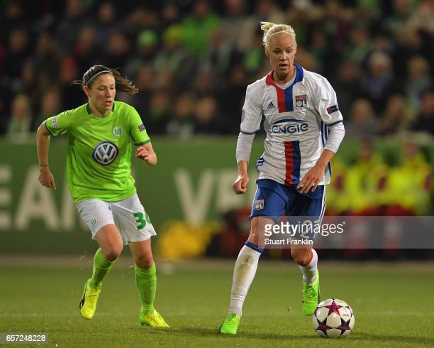 lise Bussaglia of Wolfsburg challenges Caroline Seger of Lyon during the UEFA Women's Champions League Quater Final first leg match between VfL...