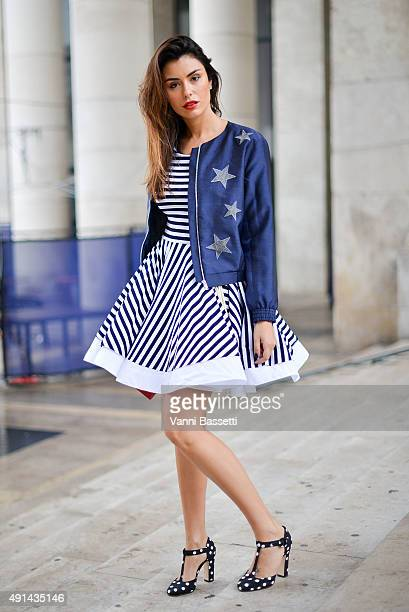 Lise Grendene poses wearing a Natasha Zinko dress Yves Saint Laurent clutch and Dolce and Gabbana shoes after the Leonard Paris show at the Palais de...