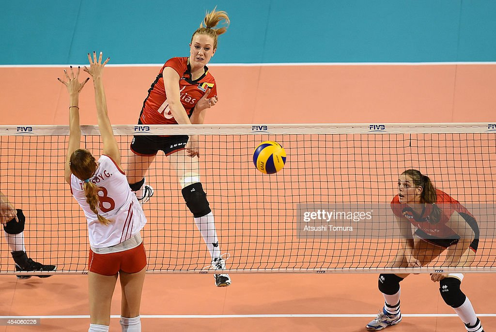 Lise Van Hecke of Belgium spikes the ball during the FIVB World Grand Prix Final group one match between Turkey and Belgium on August 24, 2014 in Tokyo, Japan.