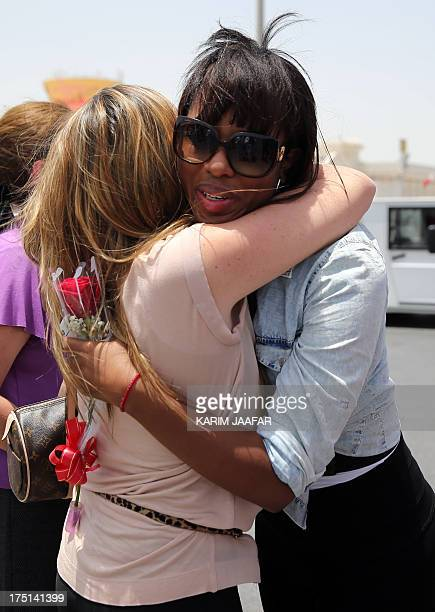 Liseth Chala the wife of deceased Ecuadorian striker Christian Benitez is hugged by an unidentified woman as she mourns while her husband's coffin is...