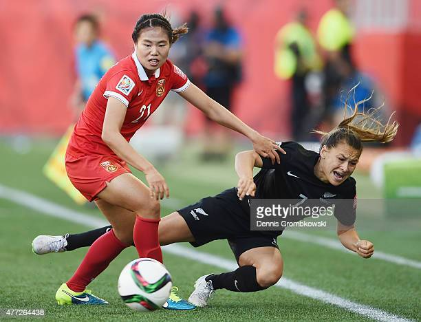 Lisi Wang of China PR challenges Ali Riley of New Zealand during the FIFA Women's World Cup Canada 2015 Group A match between China PR and New...