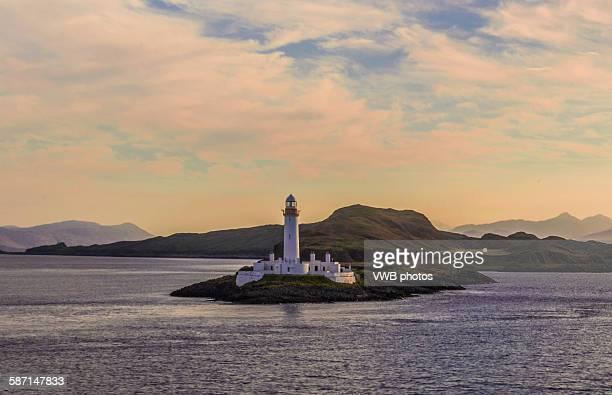 Lismore lighthouse with dramatic sky at sunrise
