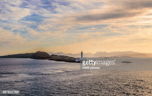 Lismore Lighthouse with dramatic sky at sunrise.