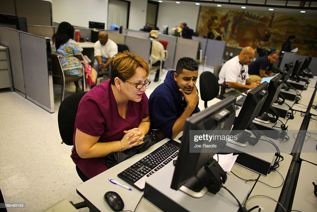 Lissette Marquez (L), who said she was laid off today from her nursing job and Amiel Ali who said he has been out of work since October 2012, look for job opportunities on the computers at South Florida Workforce February 1, 2013 in Miami, Florida. The Labor Department announced that U.S. employers added 157,000 jobs in January compared with a revised 196,000 jobs the previous month and the unemployment rate was little changed at 7.9 percent.