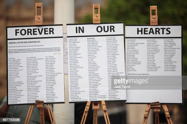 A list of some of the residents of Grenfell Tower sit on easels during a vigil for the victims of the Grenfell Fire disaster at Parliament Square on...