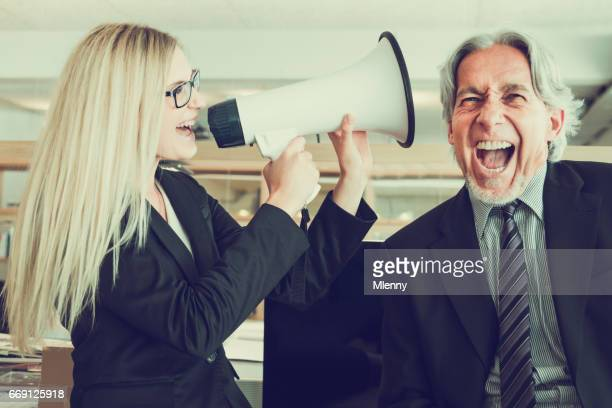 Listen to my Ideas! Businesswoman shouting with Megaphone to Senior Manager