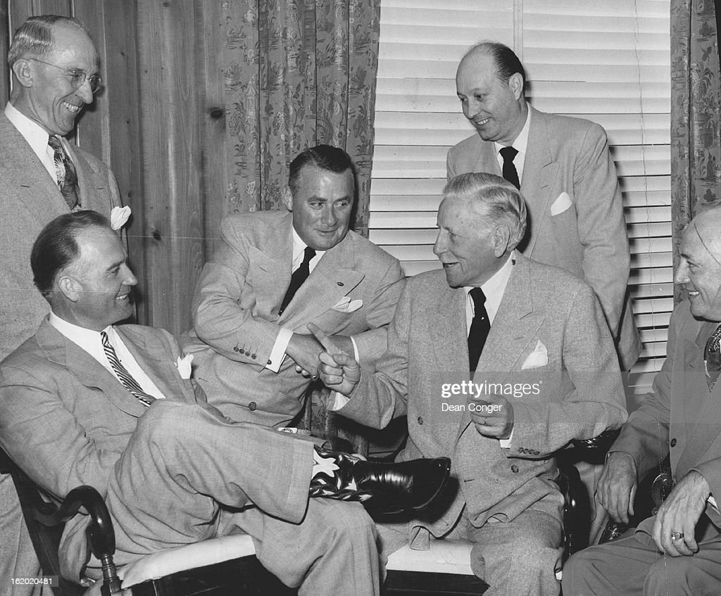 JUL 11 1951 Listening as Maj Gen Patrick J Hurley tells a story during a reception in his honor in the Brown palace hotel are Governor Thornton...