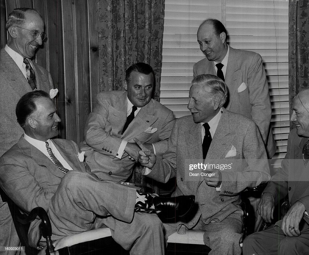 JUL 11 1951 Listening as Maj Gen Patrick J Hurley tells a story during a reception in his honor in the Brown Palace hotel are Governor Thornton WK...