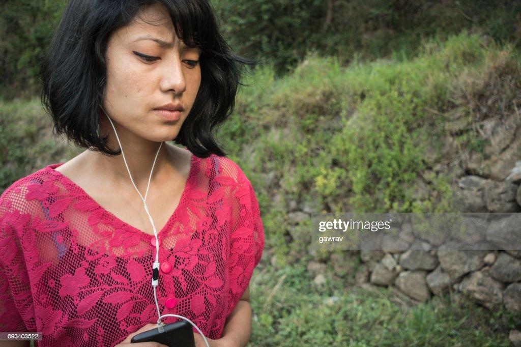Listening podcast through headphones. : Stock Photo