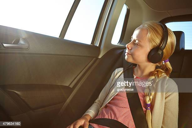 Listening to her favorite travel songs