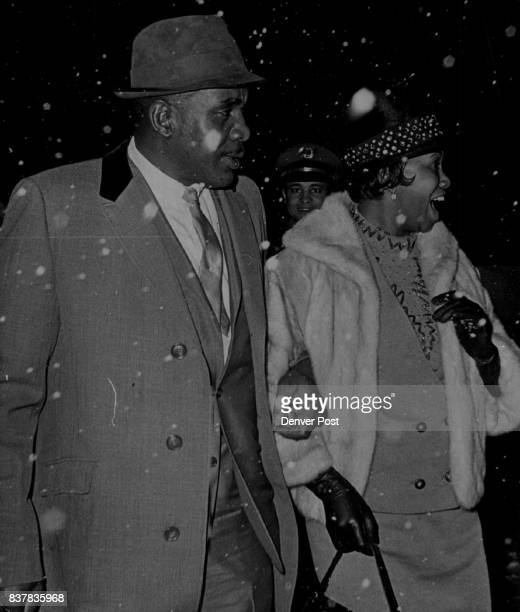 Liston Returns Home after Title Delay Former heavyweight champion Sonny Liston and his wife Geraldine after they stepped off plane into Denver...