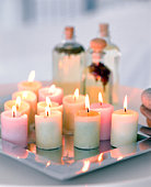 Lit aromatherapy candles on tray