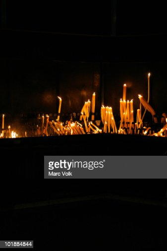 Lit candles arranged on an altar