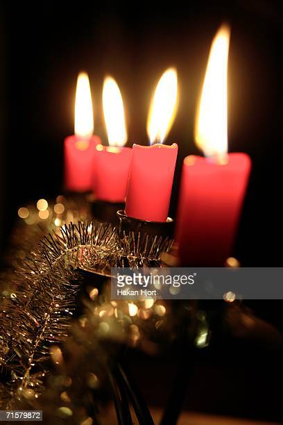 Lit candles on an Advent candlestick.