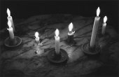 Lit candles on marble surface