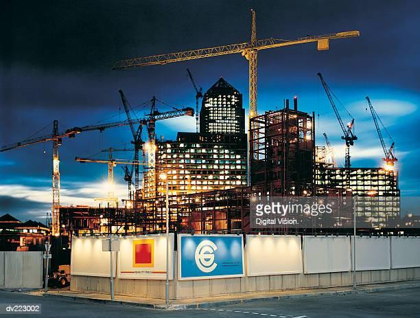 Lit construction site at dusk