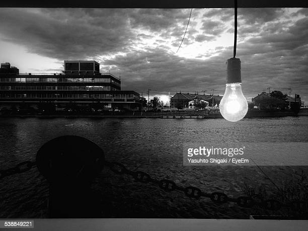 Lit Electric Bulb By River