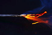 A lit fuse burns