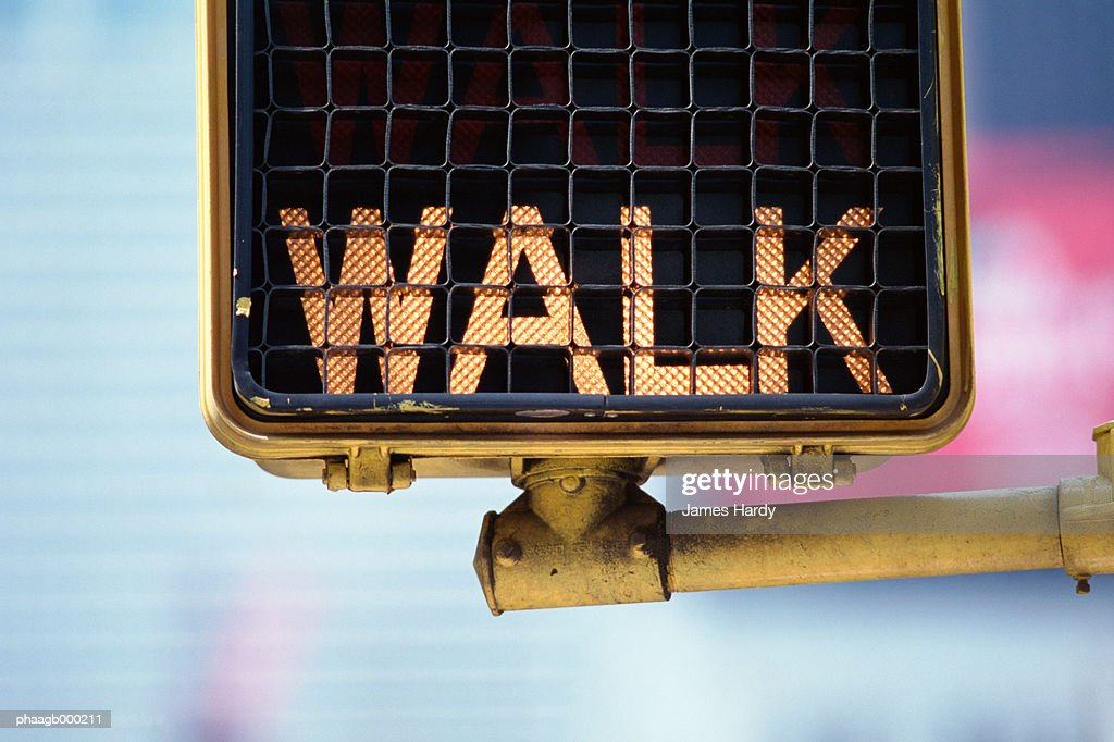 Lit pedestrian walk sign, close-up : Stock Photo