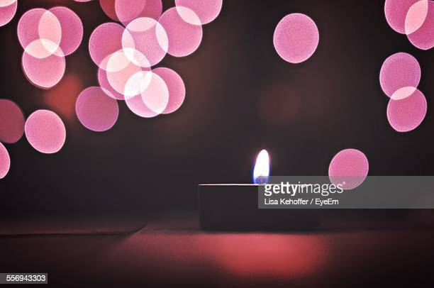 Lit Tea Light Candle On Table At Home