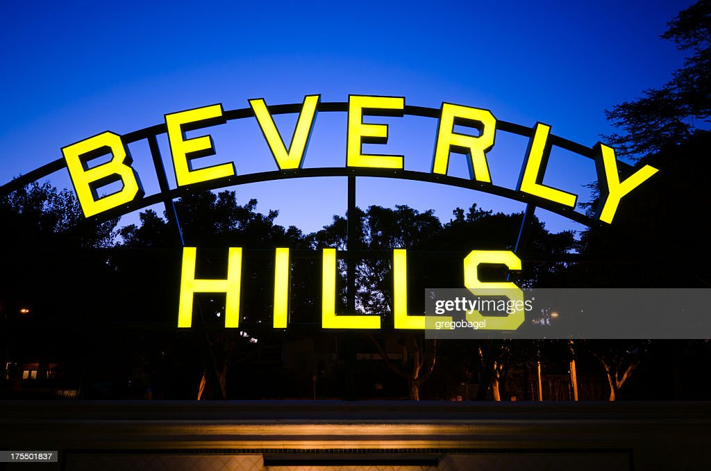 A lit up Beverly Hills sign at night