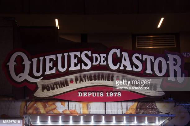 Lit up signage of Queues de Castor pastry shop above entrance door BeaverTails are a Canadianbased chain of pastry stands selling fried dough...