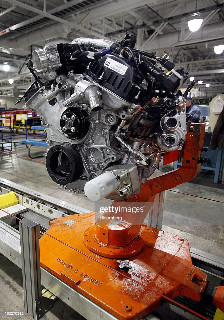 A 2.0 liter ecoboost engine moves along the production line at the Ford Motor Co. Cleveland Engine Plant in Brook Park, Ohio, U.S., on Thursday, Feb. 21, 2013. Ford Motor Co. said it will invest $200 million to make four-cylinder engines at the plant starting in late 2014 as the second-largest U.S. automaker equips an increasing number of models with smaller, more fuel-efficient powertrains. Photographer: David Maxwell/Bloomberg via Getty Images
