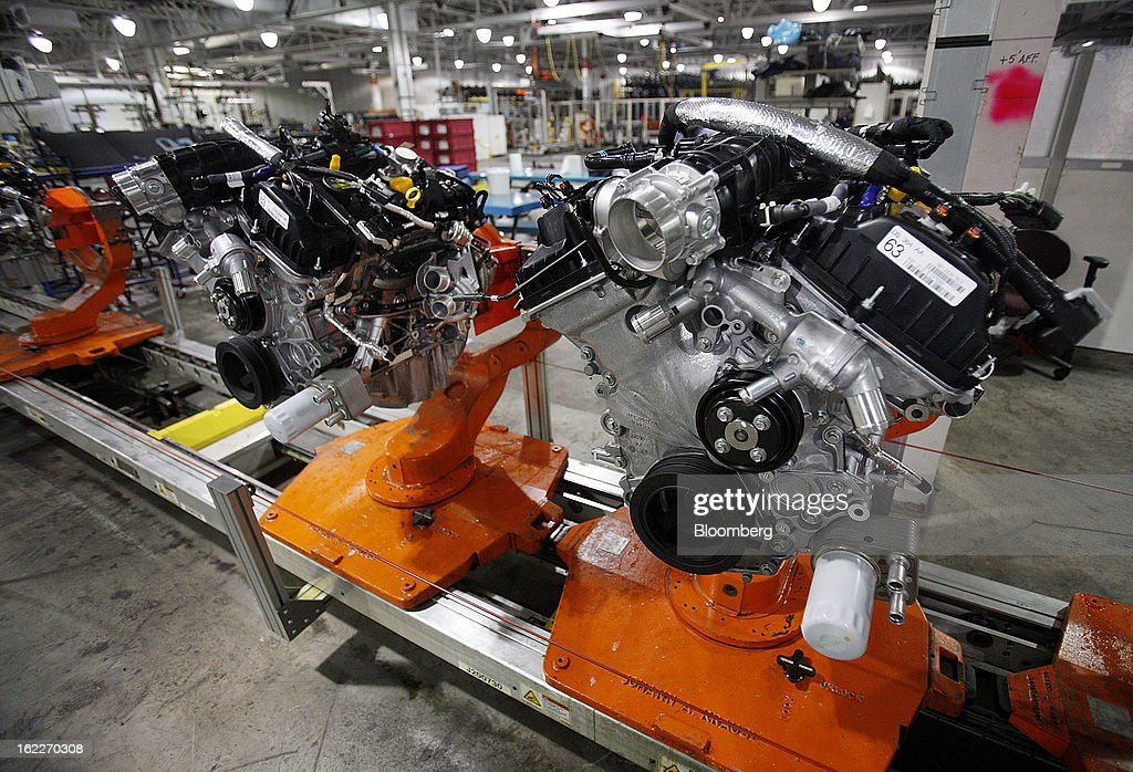 2.0 liter ecoboost engines move along the production line at the Ford Motor Co. Cleveland Engine Plant in Brook Park, Ohio, U.S., on Thursday, Feb. 21, 2013. Ford Motor Co. said it will invest $200 million to make four-cylinder engines at the plant starting in late 2014 as the second-largest U.S. automaker equips an increasing number of models with smaller, more fuel-efficient powertrains. Photographer: David Maxwell/Bloomberg via Getty Images
