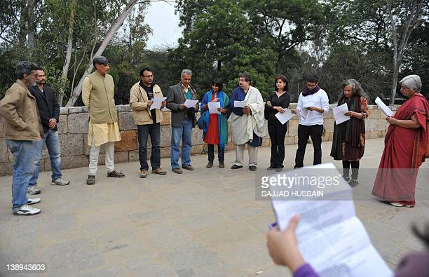 Literary activists including free speech literary critic Nilanjan Roy read book excerpts from banned authors in New Delhi on February 14 2012 The...