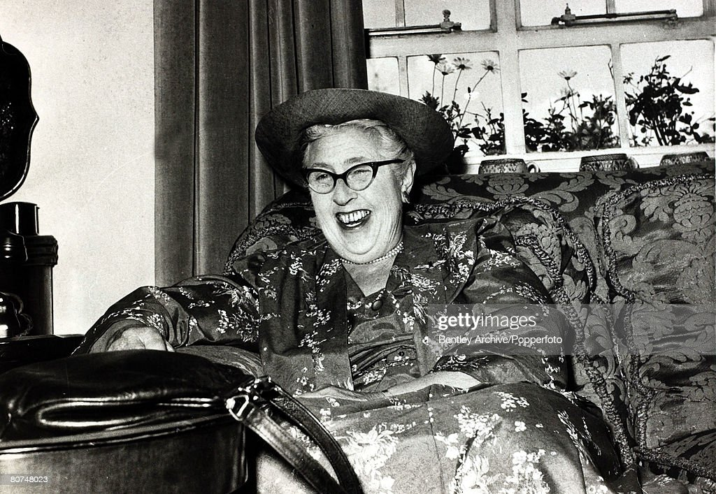 circa 1950's, English crime writer Agatha Christie in jovial mood, Agatha Christie,(1890-1976), the world's best known mystery writer, famous for her Hercule Poirot and Miss Marple stories, and for her plays including 'The Mousetrap'