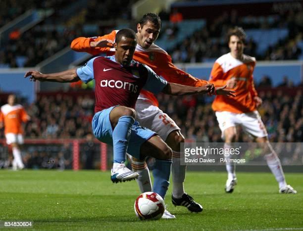 Litex Lovech's Petar Zanev and Aston Villa's Wayne Routledge battle for the ball