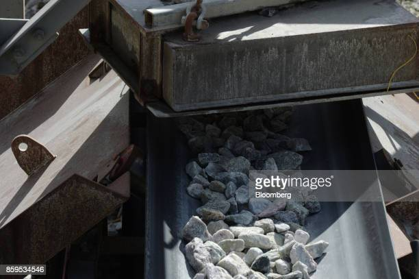 Lithium ore moves along a conveyor at a Talison Lithium Ltd facility a joint venture between Tianqi Lithium Corp and Albemarle Corp in Greenbushes...