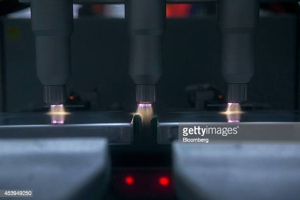 Lithiumion battery cells manufactured by Samsung SDI Co are cleaned with plasma gas at the Bayerische Motoren Werke AG automobile manufacturing plant...