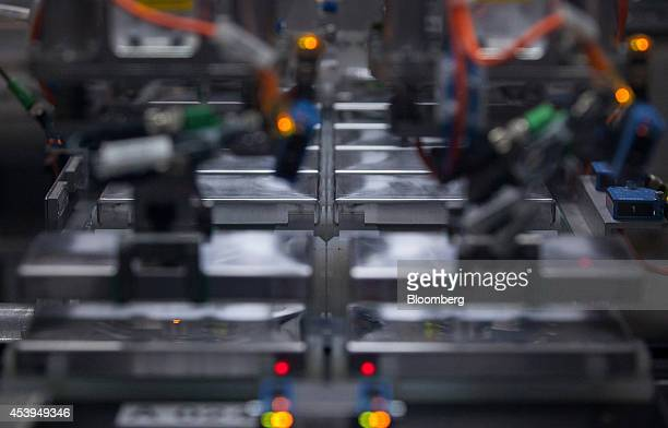 Lithiumion battery cells manufactured by Samsung SDI Co sit on the production line before battery module assembly at the Bayerische Motoren Werke AG...