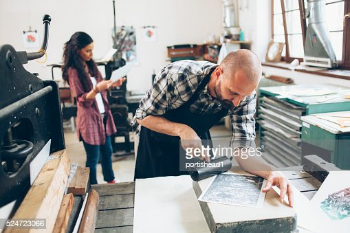 Lithography workers creating pattern at workshop