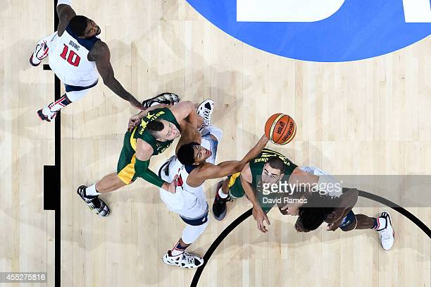 Lithuania Basketball Men's National and USA Basketball Men's National Team players duel for the ball during a 2014 FIBA Basketball World Cup...