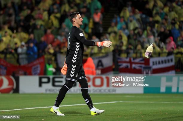 Lithuania goalkeeper Vykintas Slivka removes a bottle that was thrown onto the pitch during the 2018 FIFA World Cup Qualifying Group F match at the...