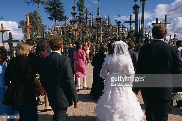 Lithuania Hill of Crosses Wedding group in front of hundreds of crosses and crucifix at ancient pilgrimage site near Siaulial