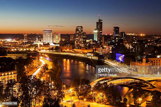 Lithuania, Vilnius, Illuminated riverfront cityscape seen from elevation on opposite bank