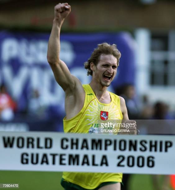 POSITIONS Lithuanian Edvinas Krungolcas celebrates at the end of the men's 3000m race as he wins with 5588 points the 2006 Modern Pentathlon World...