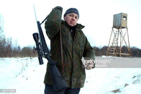 BENIUSIS Lithuanian hunter Giedrius Kantaravicius of Hunting Club Varcia stands near a hunting tower where he will wait for wild boar in Varcia...