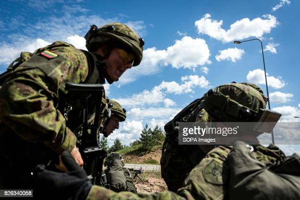 Lithuanian infantry prepare to advance onto a town held by 'separatists' during Saber Strike exercises Image taken during a NATO hosted military...