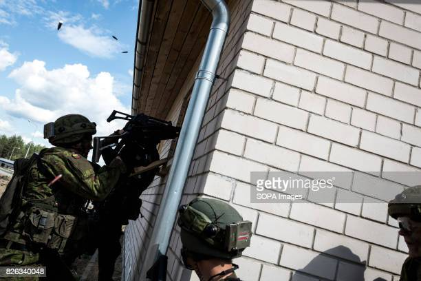 Lithuanian infantry storms a house occupied by the 'separatists' during Saber Strike exercises Image taken during a NATO hosted military training...