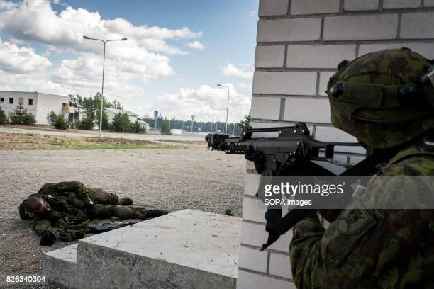 Lithuanian infantry together with US forces get bogged down in heavy urban fighting A Lithuanian soldier is 'injured' in the firefight Image taken...
