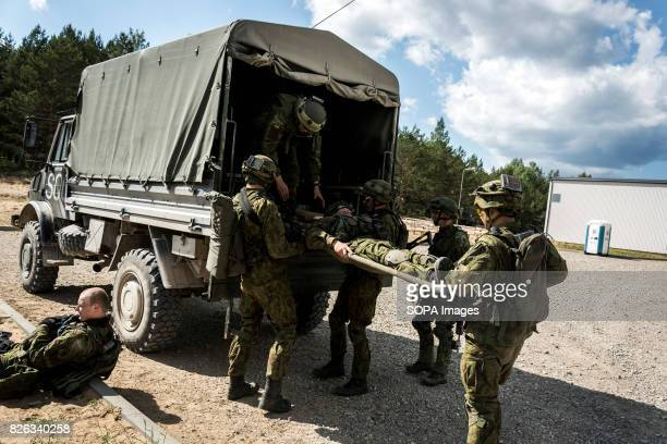 Lithuanian infantry use one of the newly acquired Mercedes 'Unimog' trucks to evacuate one of the 'mock' wounded during Saber Strike exercises Image...