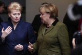 Lithuanian President Dalia Grybauskaite and German Chancellor Angela Merkel arrive for the 'Family Photo' during the European Council Meeting on...