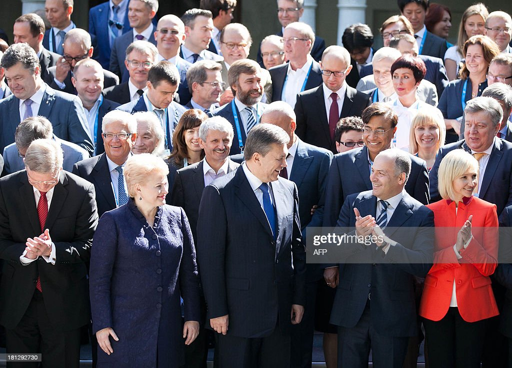 Lithuanian President Dalia Grybauskaite (2nd R) and her Ukrainian counterpart Viktor Yanukovych (3rd R) pose with participants during the 10th Yalta Annual Meeting in the Ukrainian resort of Yalta on September 20, 2013. Dalia Grybauskaite condemned on September 20, 'pressures' from third party countries on Ukraine to push it to renounce to a partnership agreement with the European Union.